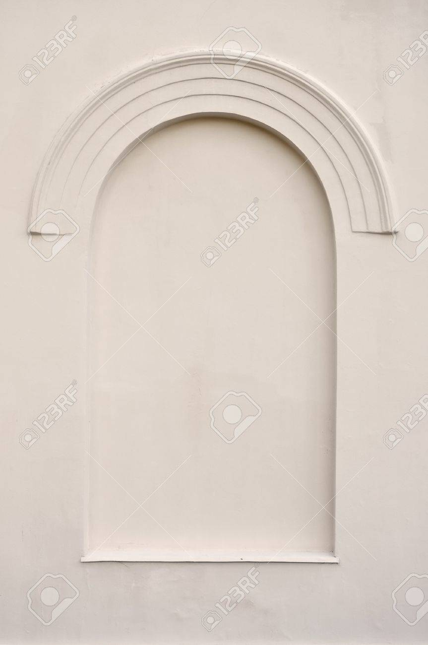 Old aged plastered faux arch false fake window stucco frame background copy space, light dark beige sepia texture Stock Photo - 14965714