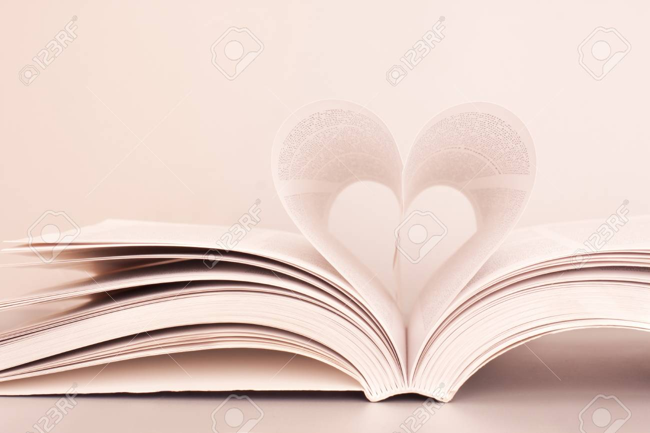 Pages of a book forming the shape of the heart. Stock Photo - 9056574