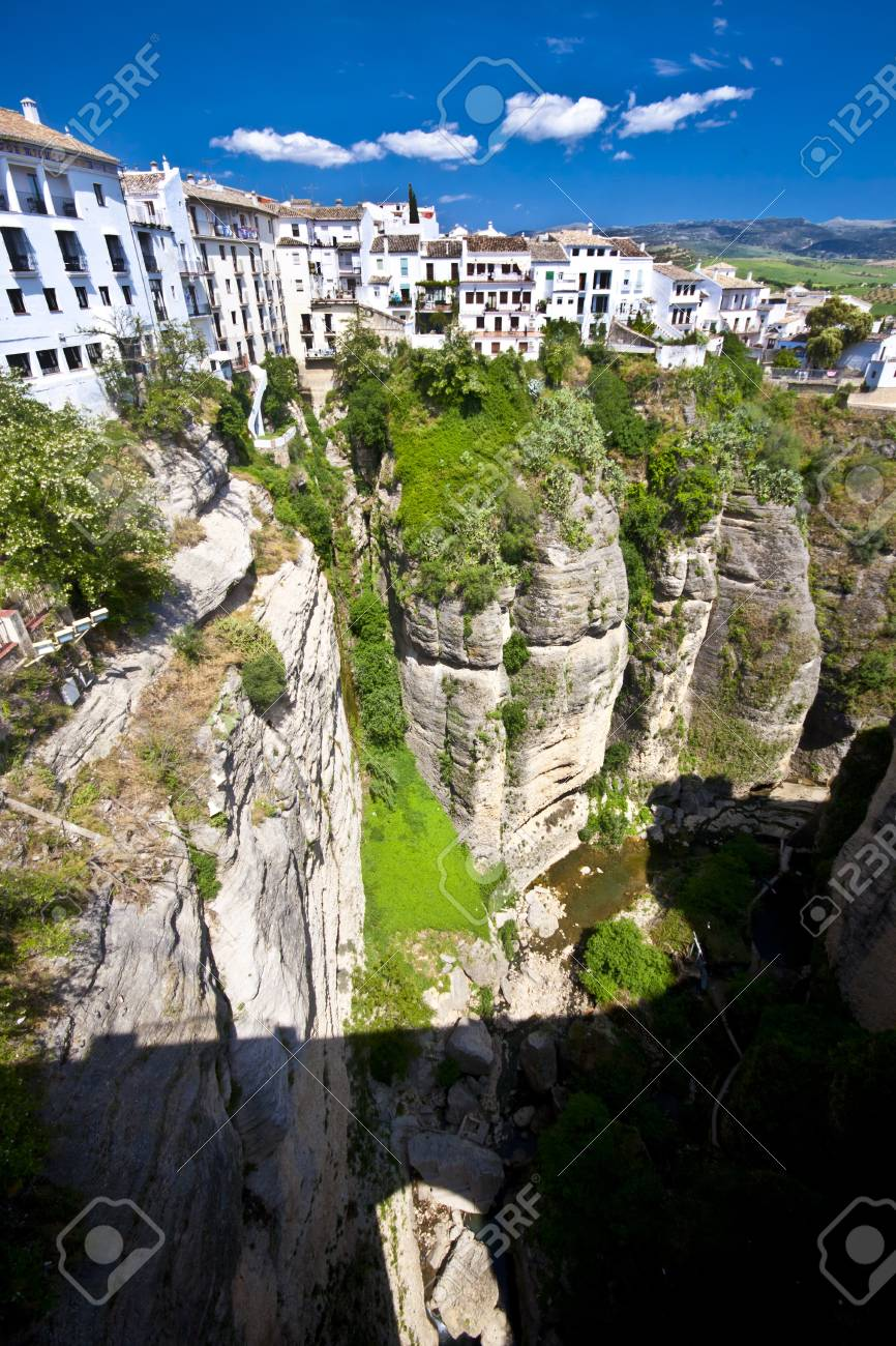 Panoramic view from a new bridge in Ronda, one of the famous white villages in Andalusia, Spain Stock Photo - 9711230