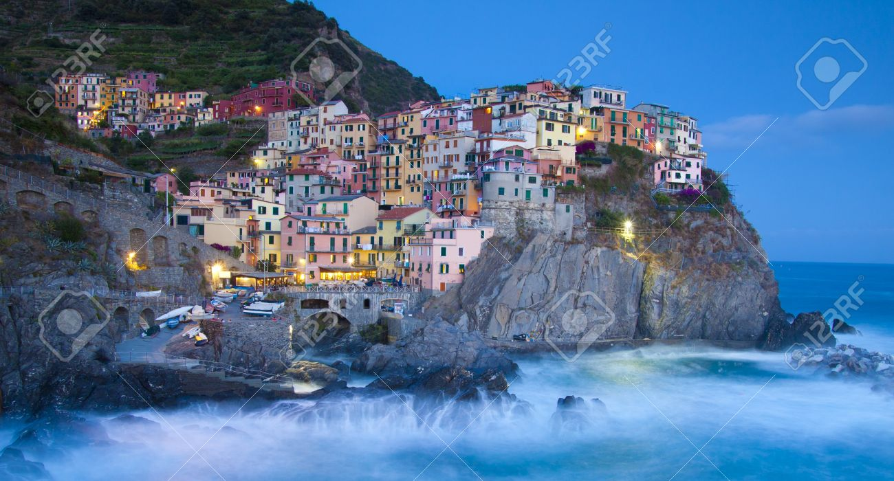 Manarola fisherman village in a dramatic wind storm. Manarola is one of five famous villages of Cinque Terre (Nationa park), suspended between sea and land on sheer cliffs upon the wild waves. Stock Photo - 10065090