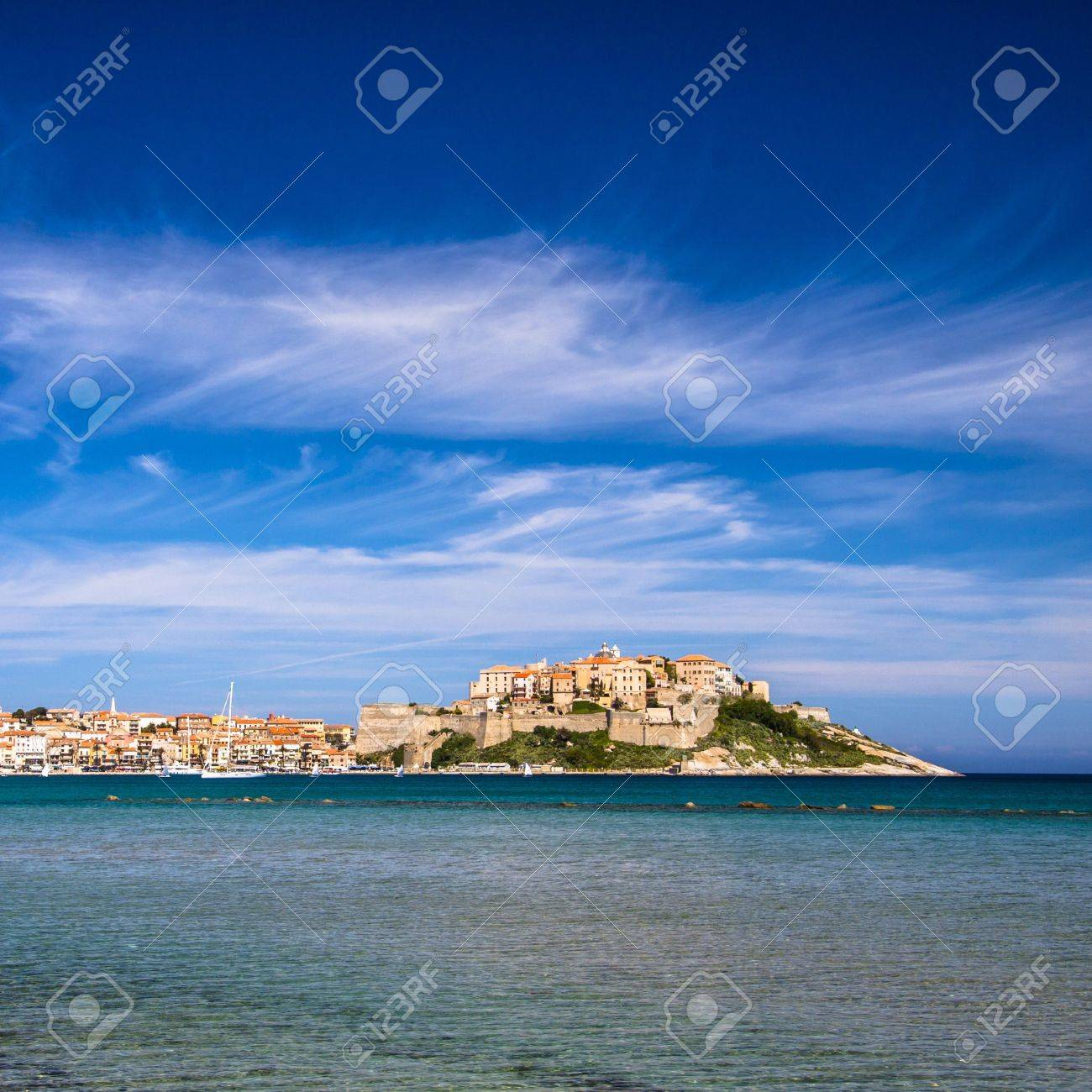 Calvi - Colorful coastal town on the island of Corsica, France. According to legend, Christopher Columbus supposedly was born there. - 13769148
