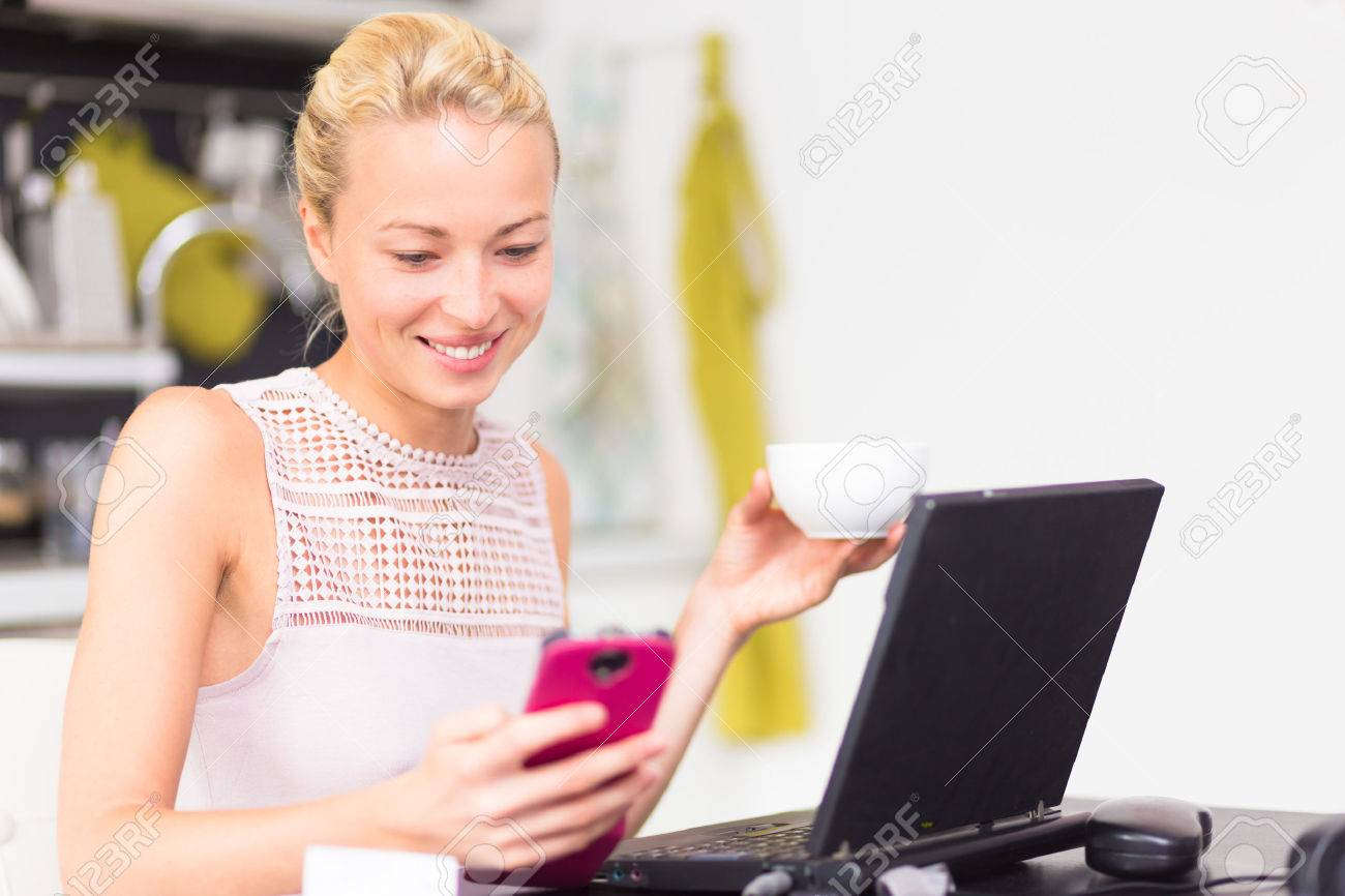 working independently images stock pictures royalty working working independently business w working from her home having morning coffee while texting on