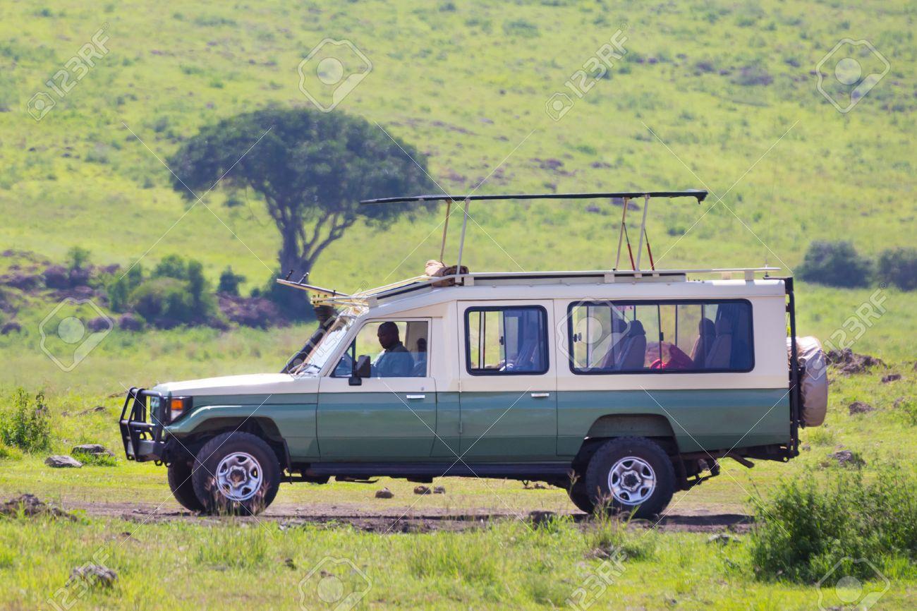 Open Roof 4x4 Safari Jeep On African Wildlife Safari Stock Photo