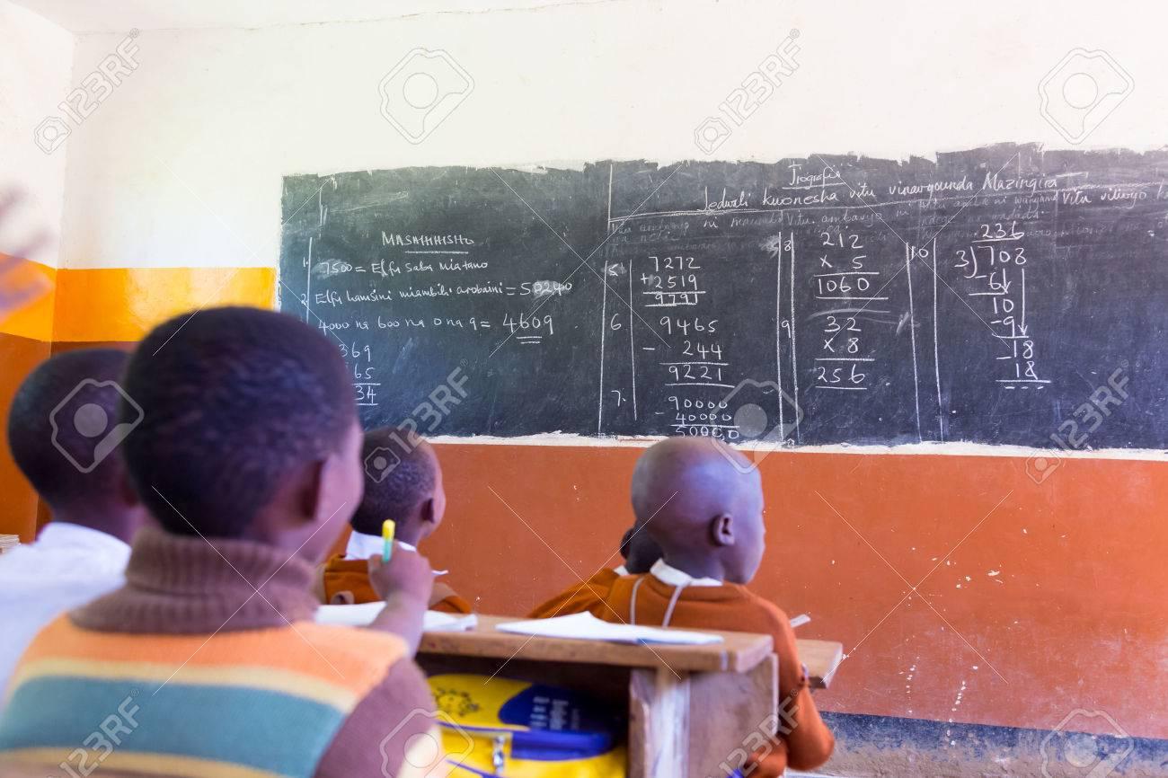 Rural african school with school children at their desks in classroom in North Tanzania, Africa. - 39690528