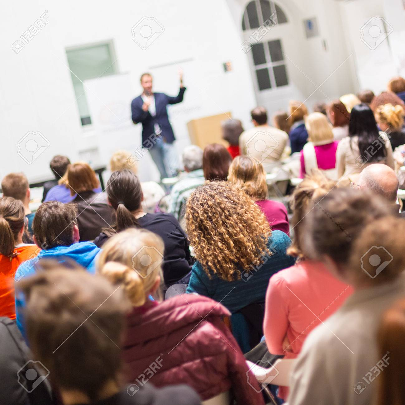Speaker Giving a Talk at Business Meeting. Audience in the conference hall. Business and Entrepreneurship. Copy space on white board. - 39790967