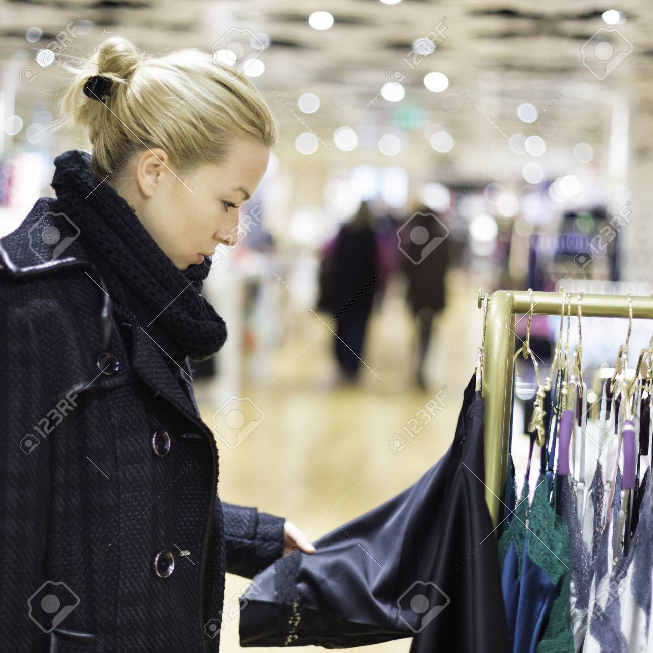 Woman Shopping Lingerie . Shopper Looking And Choosing Clothing ...