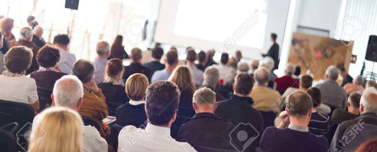 Speaker Giving a Talk at Business Meeting. Audience in the conference hall. Business and Entrepreneurship. Panoramic composition suitable for banners. - 50642443