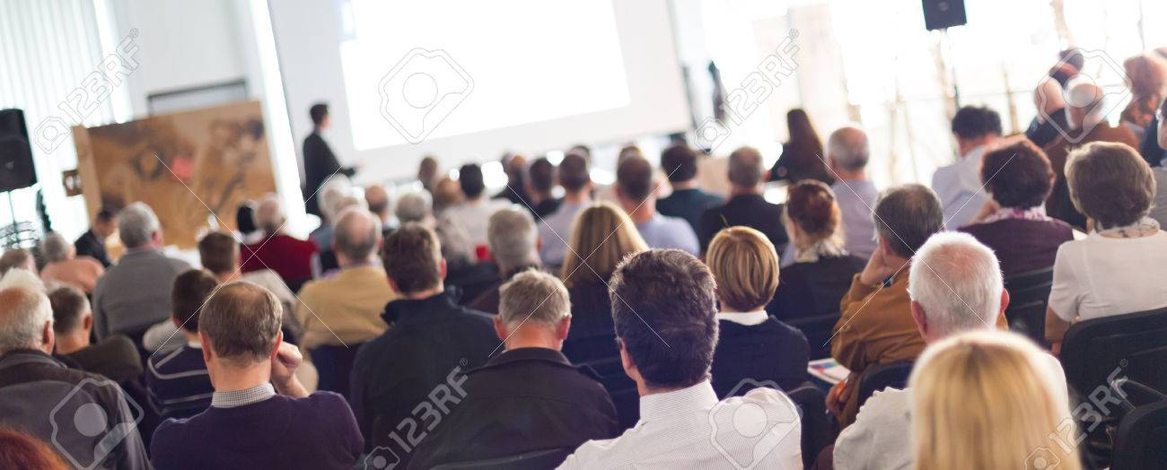 Speaker Giving a Talk at Business Meeting. Audience in the conference hall. Business and Entrepreneurship. Panoramic composition suitable for banners. Standard-Bild - 50642533