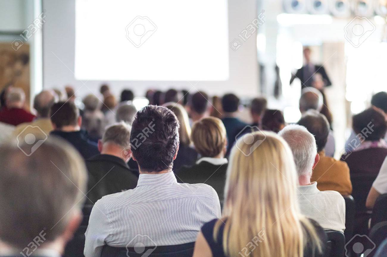 Speaker Giving a Talk at Business Meeting. Audience in the conference hall. Business and Entrepreneurship. Standard-Bild - 52128490