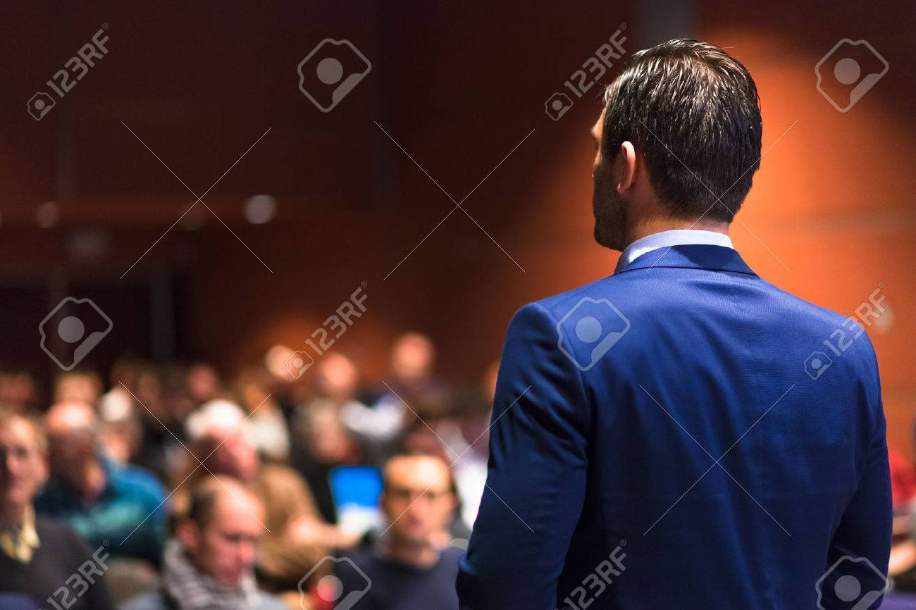Speaker giving a talk on corporate Business Conference. Audience at the conference hall. Business and Entrepreneurship event. Standard-Bild - 53599727