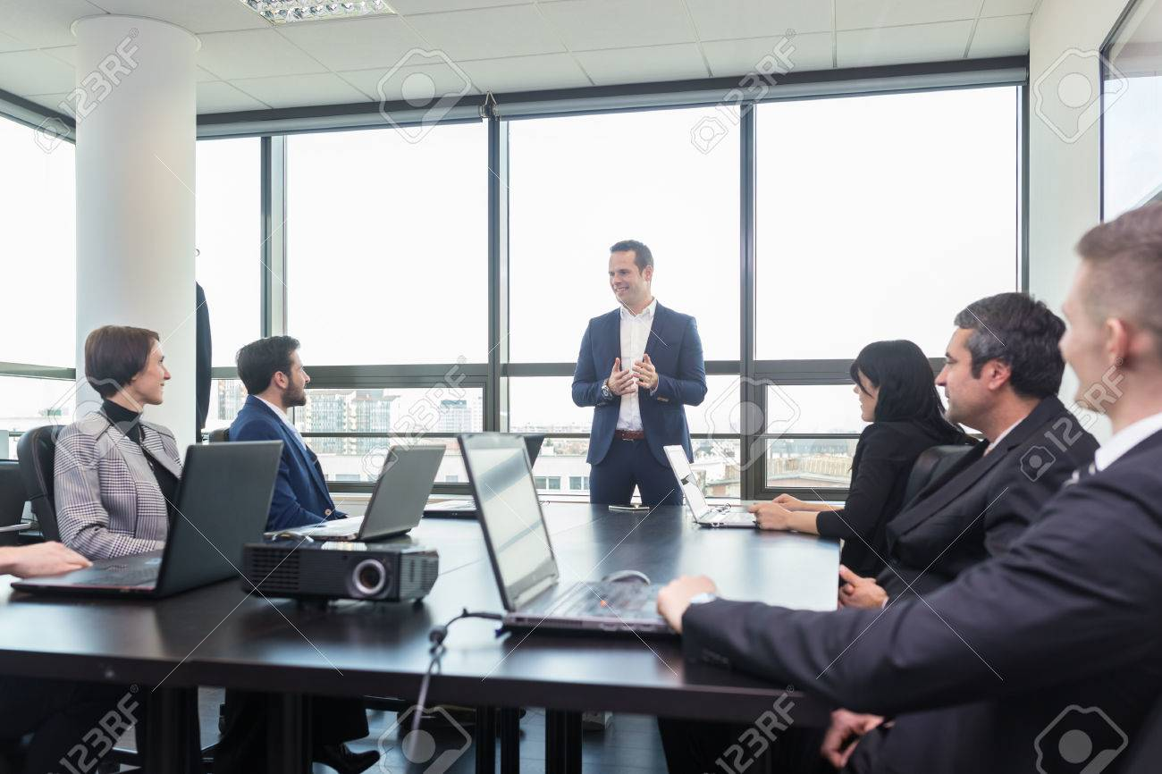 Successful team leader and business owner leading in-house business meeting, explaining business plans to his employees. Business and entrepreneurship concept. - 54811453