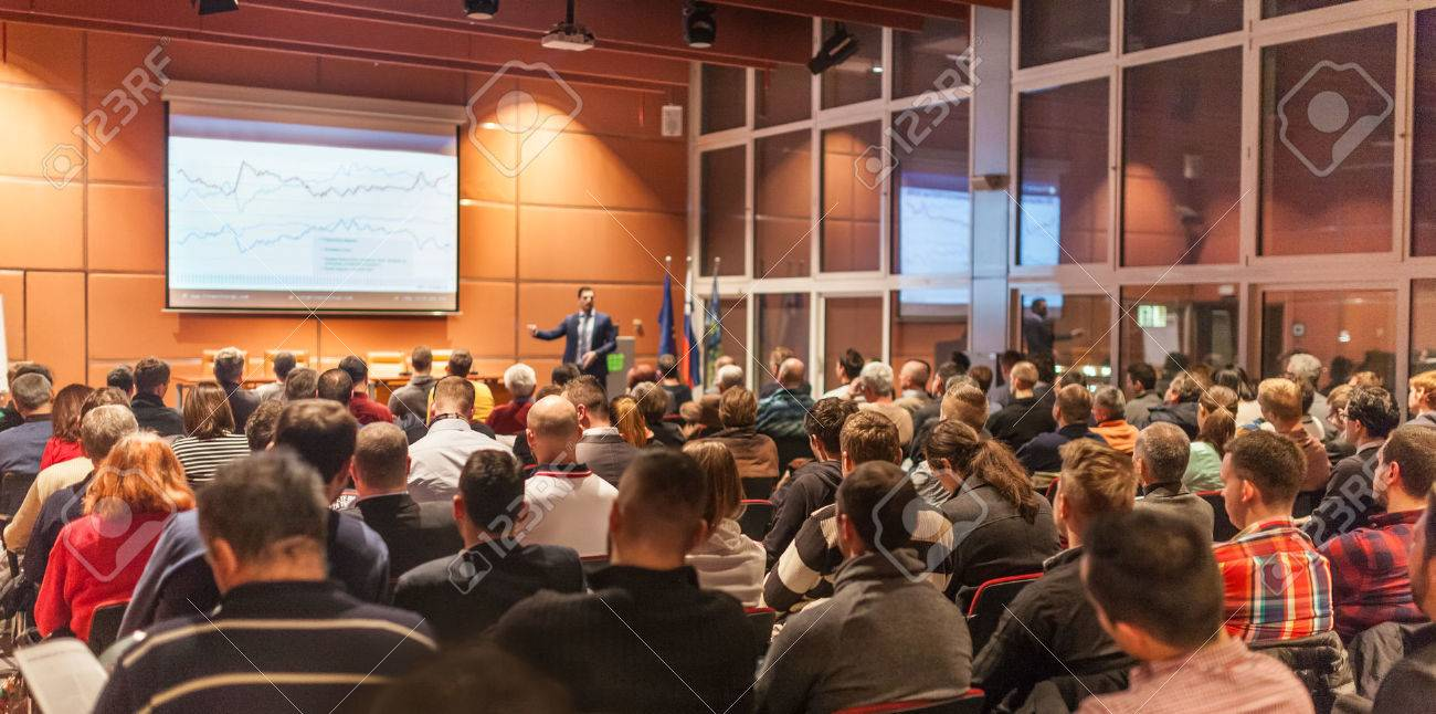 Speaker giving a talk in conference hall at business event. Audience at the conference hall. Business and Entrepreneurship concept. Standard-Bild - 61866918