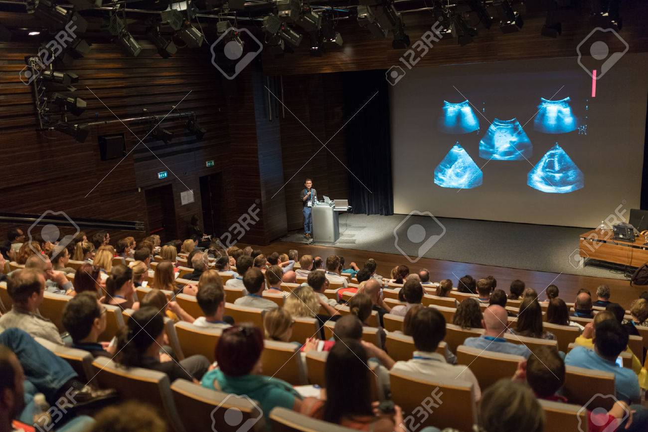 Speaker giving a talk on scientific conference. Audience at the conference hall. Business and Entrepreneurship concept. Standard-Bild - 65288865