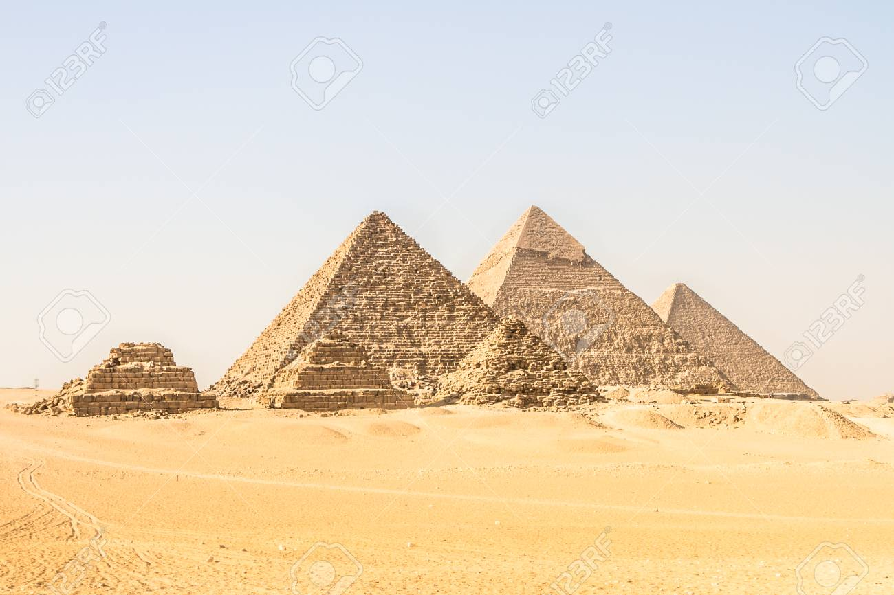 Giza pyramids in Cairo, Egypt. General view of pyramids from the Giza Plateau Three pyramids known as Queens Pyramids on front side. Next in order from left, the Pyramid of Menkaure, Khafre and Chufu - 87395943