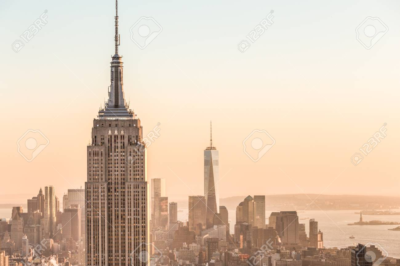 New York City. Manhattan downtown skyline with illuminated Empire State Building and skyscrapers at sunset. USA. - 96729495