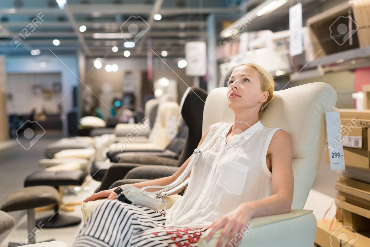 Caucasian Woman Shopping For Recliner And Home Decor In Furniture Store Lady Sitting On Rocking