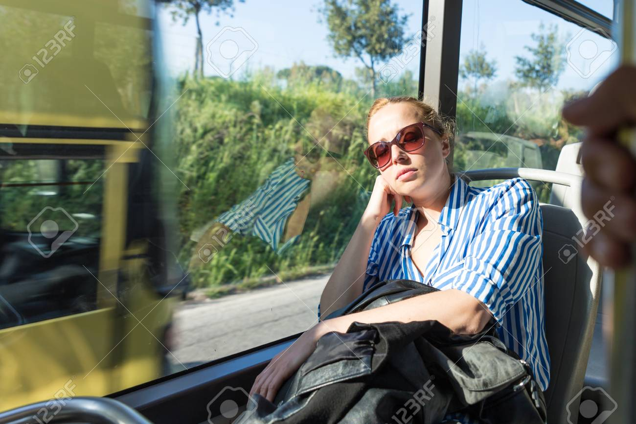 Portrait of woman sleeping on moving bus by window  Tired passenger