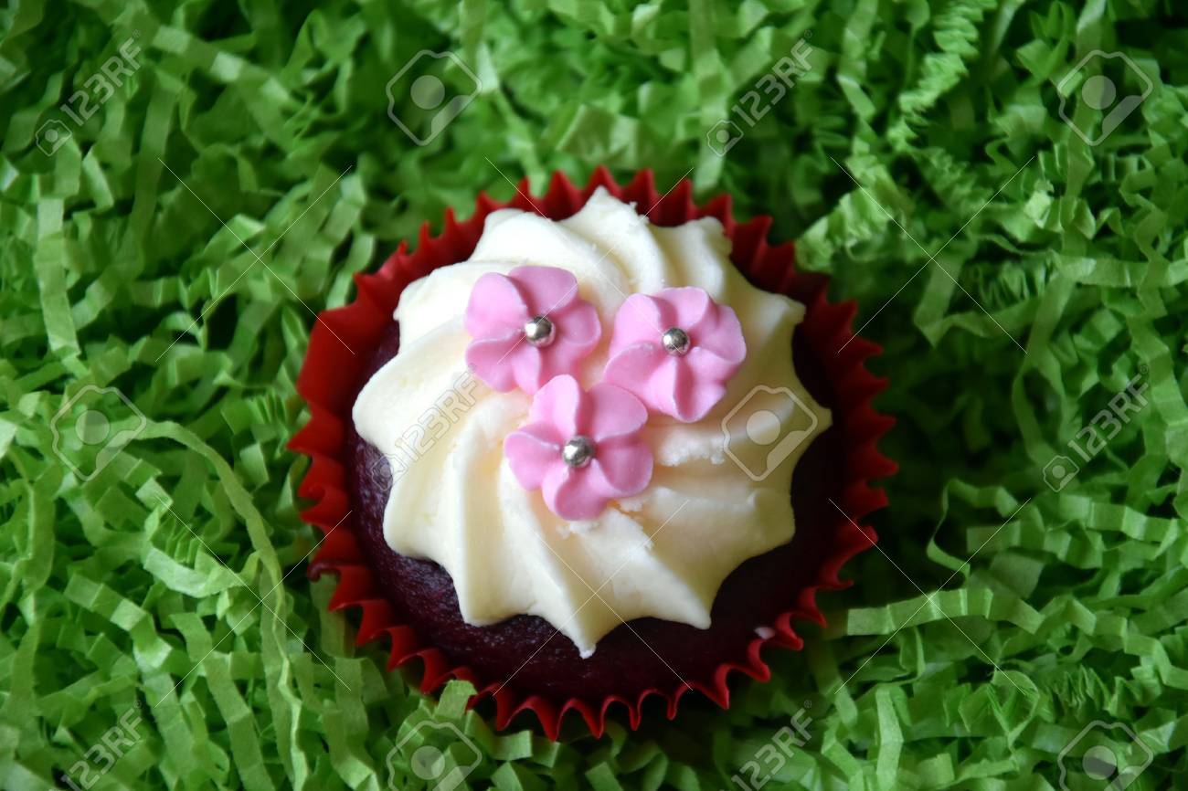Muffins Decorated With Pink Flowers On Green Background Spring