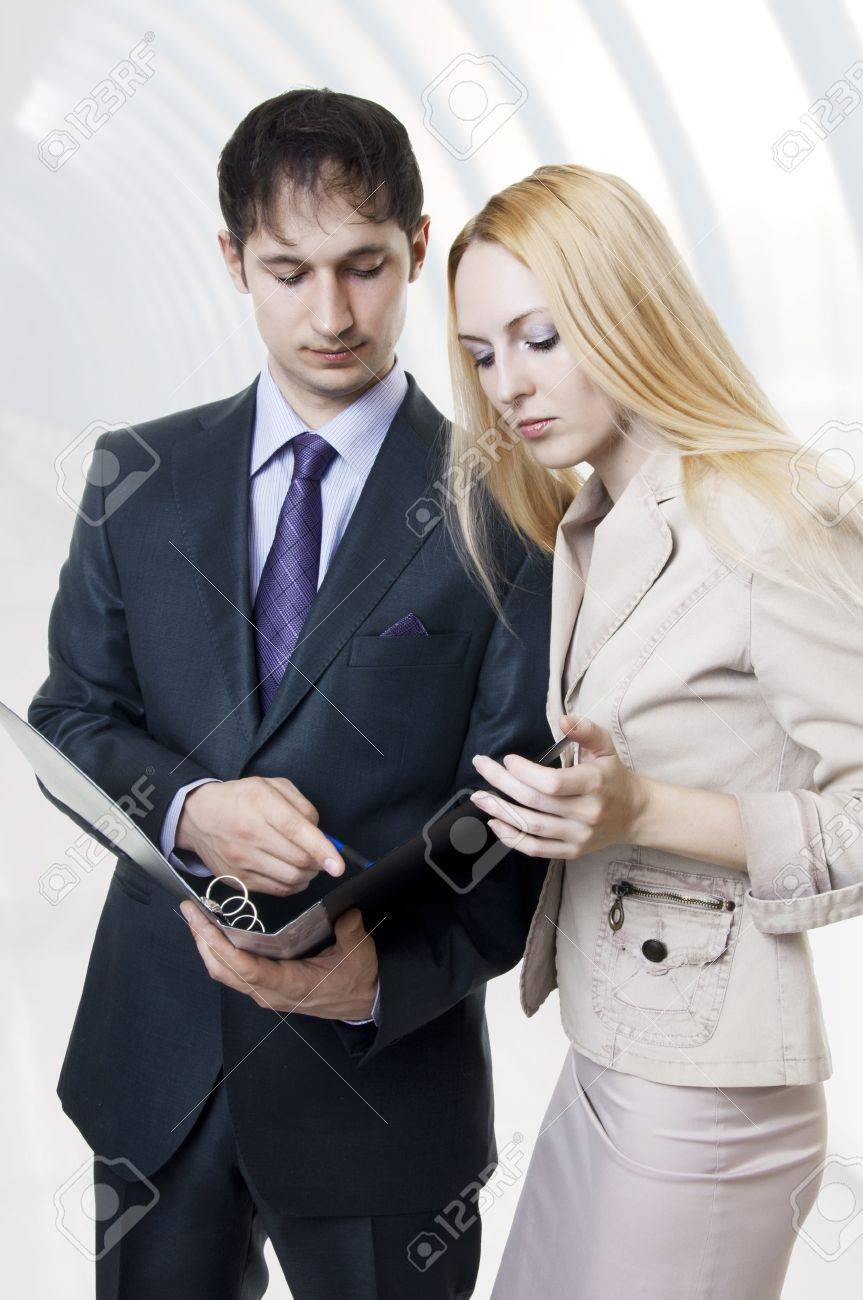 Two businessmen discussing in modern hall of office building. Business woman and man team. Stock Photo - 9138974
