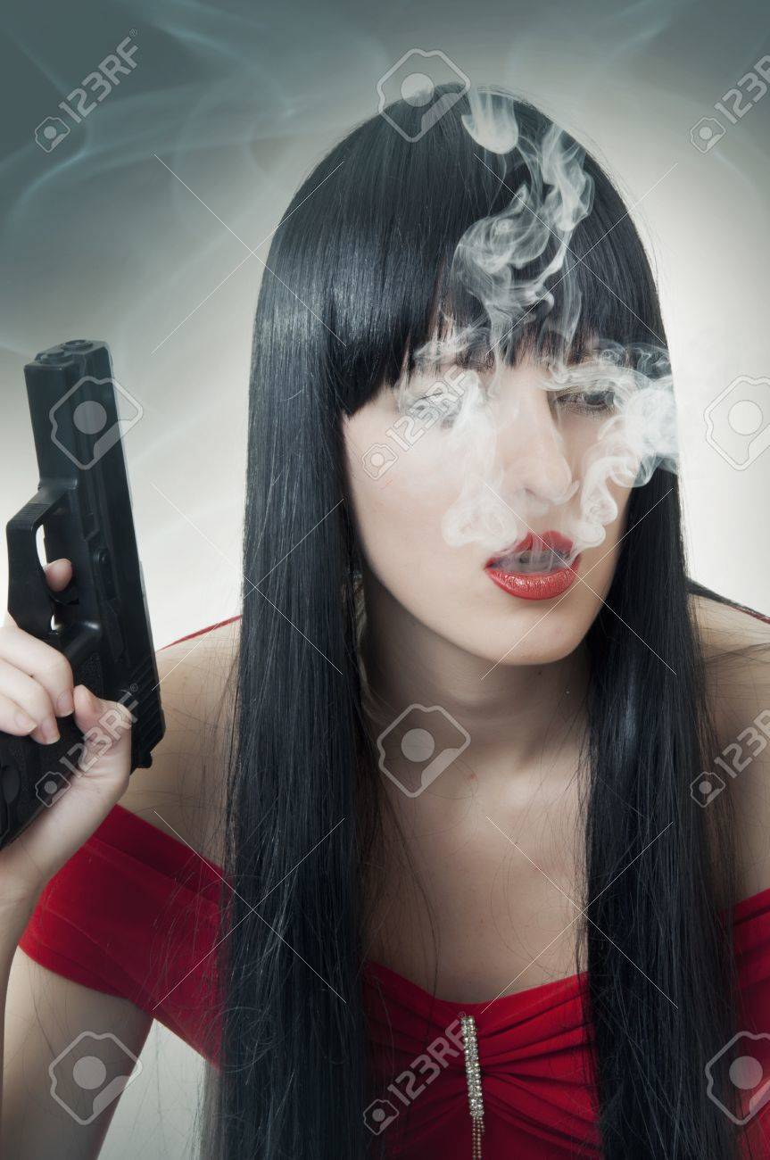 Fashion portrait of woman with handgun and cigarette Stock Photo - 10081064