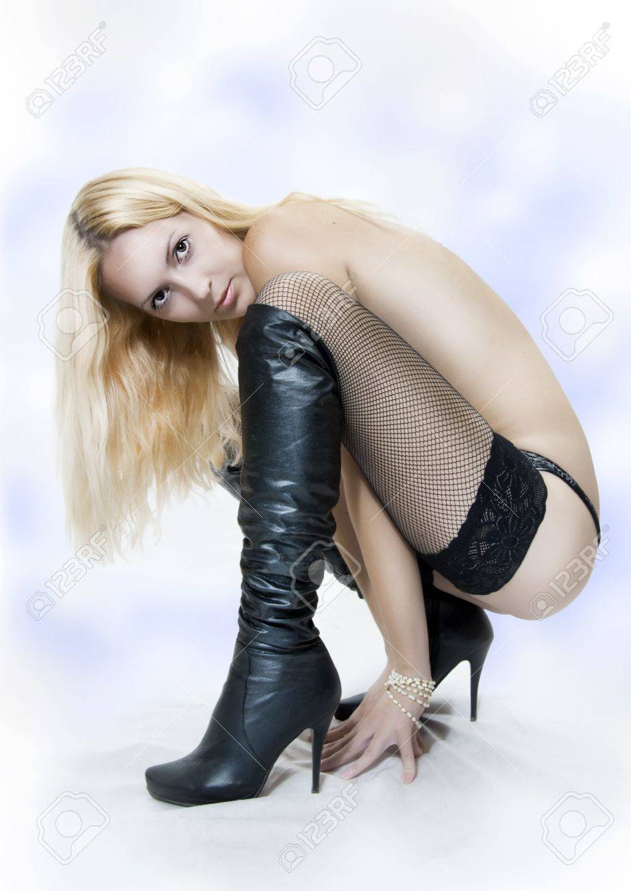 Fashion portrait of nude sexy woman in long black boots and stockings Stock Photo - 10260136