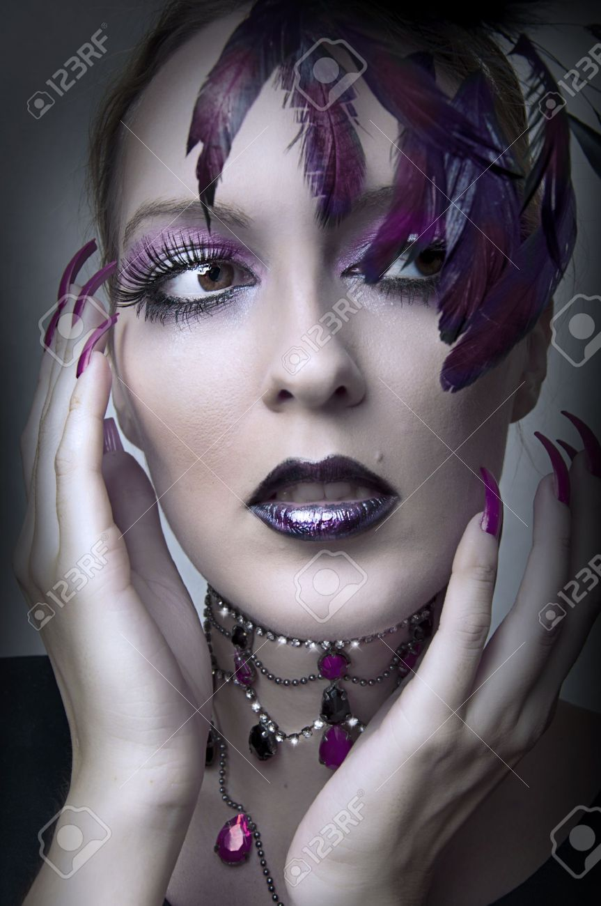 Fashion portrait of retro glamour woman with purple makeup and feathers Stock Photo - 10378684