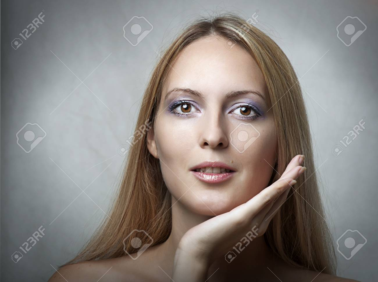 Beauty portrait of young elegant cute model. Face closeup with natural makeup Stock Photo - 10421349