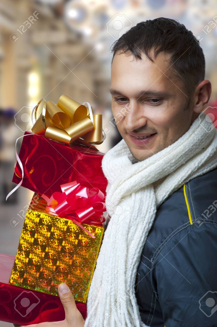 Young Adult Handsome Man With Christmas Gifts Or Presents Busy ...