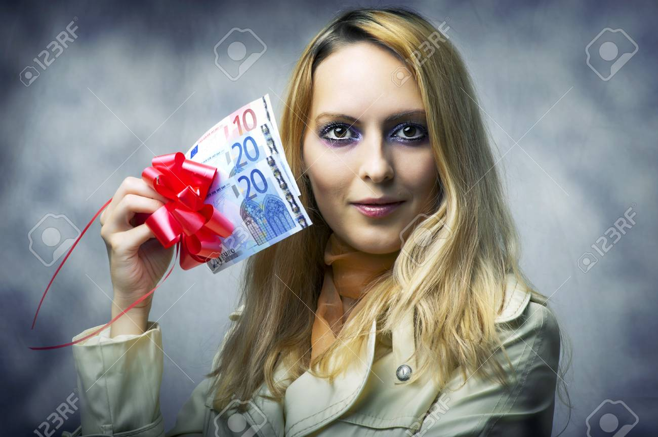 Fashion portrait of young beautiful woman winner holding money - 50 (fifty) euro. Stock Photo - 11015477