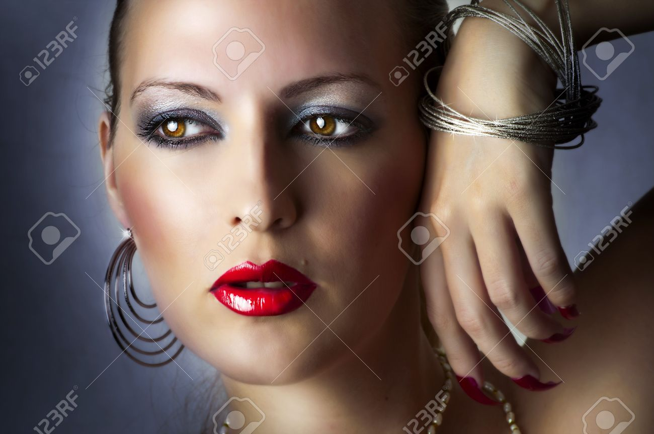 Fashion beauty portrait of sexy girl. Beautiful female face with bright glamour make-up. Woman and jewelry - silver earrings, bracelet closeup Stock Photo - 11072392