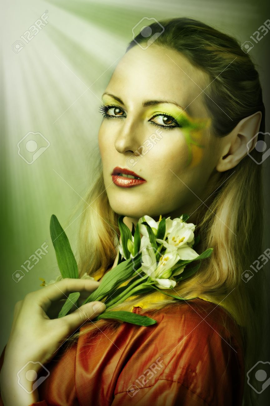 Fashion portrait of young sexy woman with creative green spring or summer make-up Stock Photo - 12120689