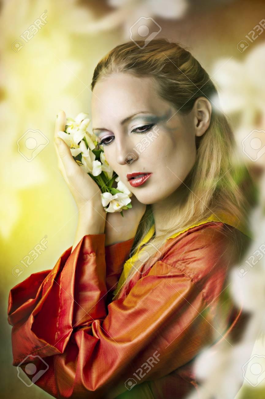 Fashion fairytale portrait of young beautiful woman with flowers fashion fairytale portrait of young beautiful woman with flowers in the light garden with creative make izmirmasajfo Image collections