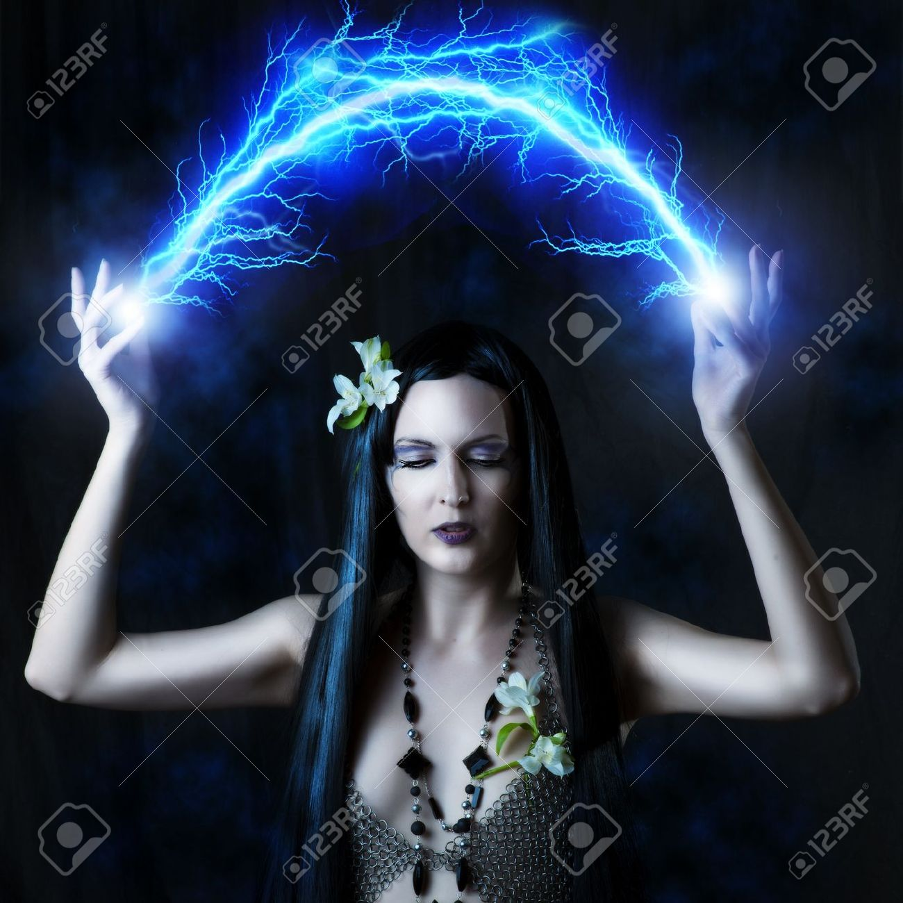 fashion portrait of woman witch or elf she is making