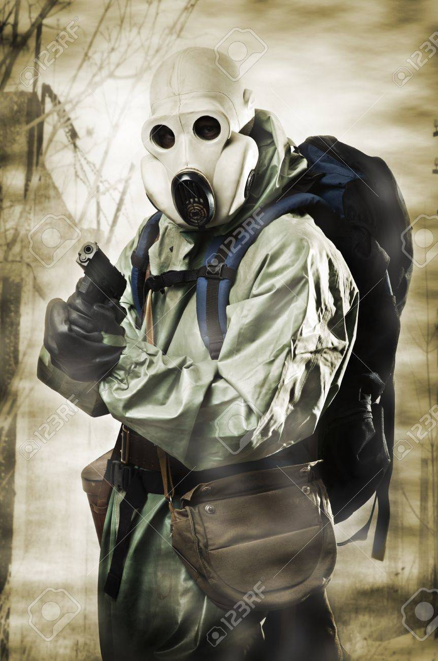 Doomsday. Man in gas mask with gun and backpack Stock Photo - 12899554