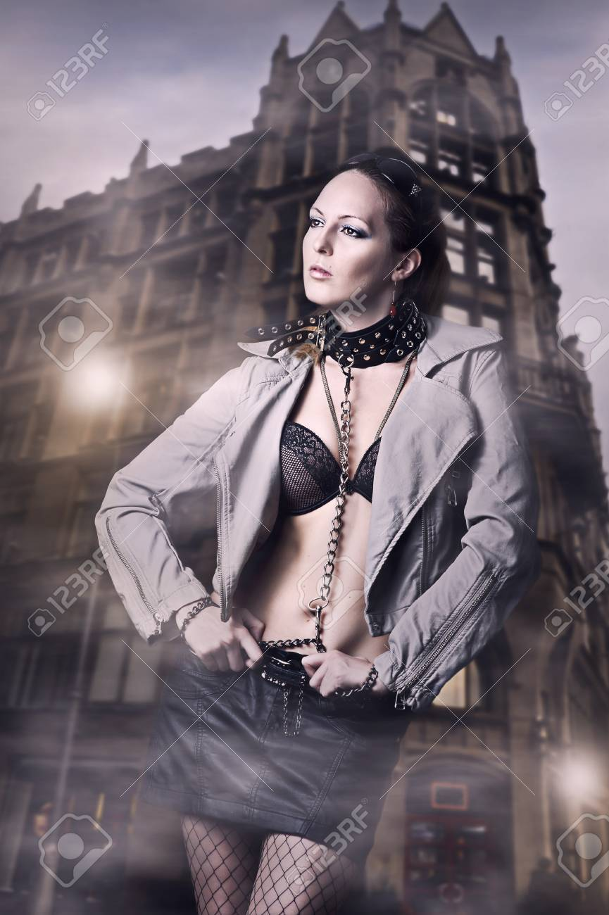 Sexy woman in leather jacket and skirt in the city Stock Photo - 13050666