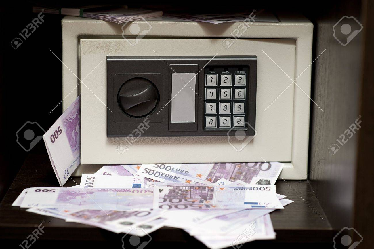 Little steel electronic safe with money (500 euro banknotes). bank safe with the digital lock add million (1000000) euro concept Stock Photo - 14309303