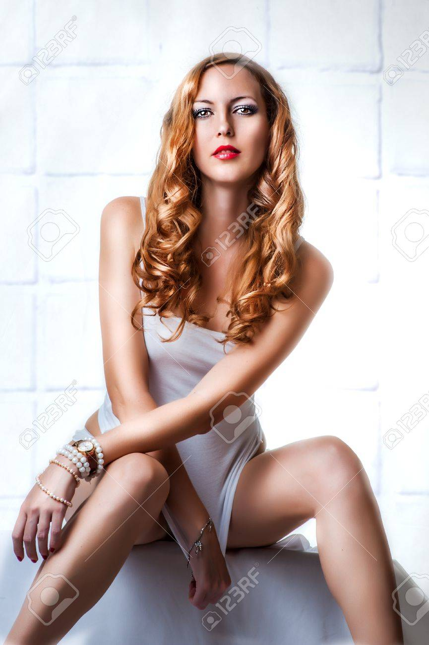 Young sexy beautiful woman in white lingerie, wearing wristwatch and bracelets Stock Photo - 16216569