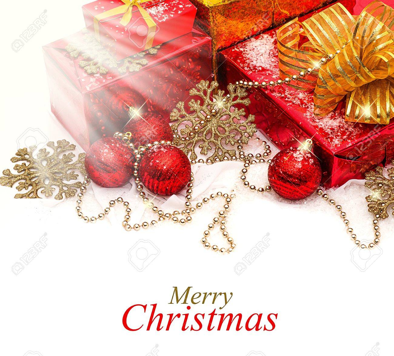 composition - Red and gold Christmas gifts and decorations on a white snow Stock Photo - 16279924
