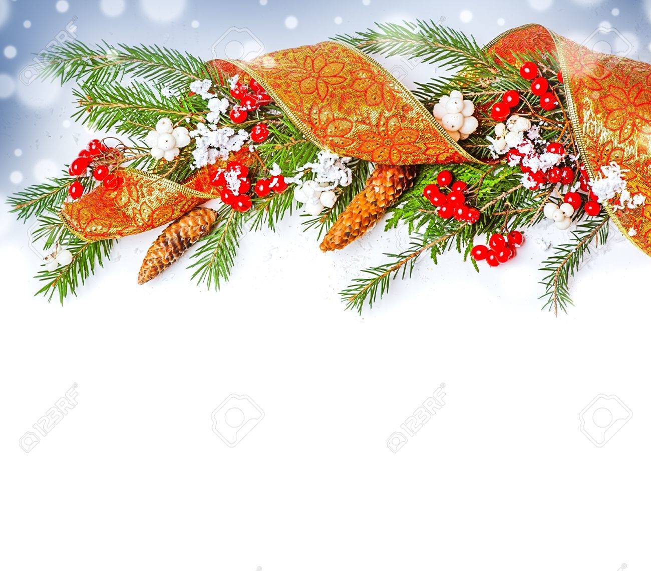 Christmas Decorations border  - ribbon, berry, con on fir tree branch Stock Photo - 16279941