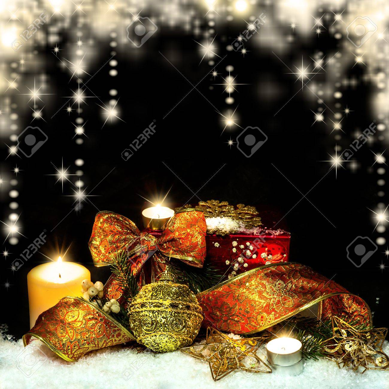 Christmas Decorations background - ribbon; ball, tree candles on fir tree branch Stock Photo - 16392890