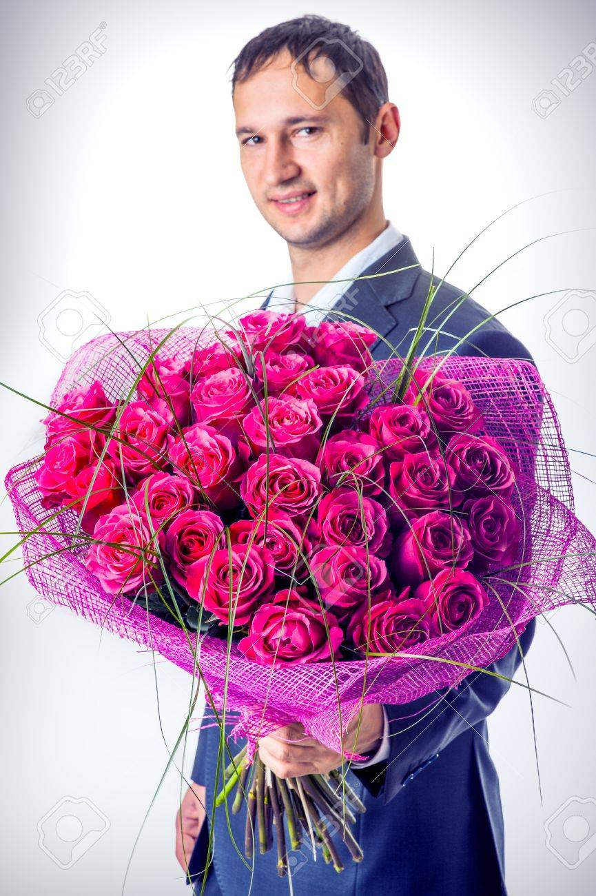 Valentines Day. Man Holding Big Bouquet Of Flowers. Proposal.. Stock ...