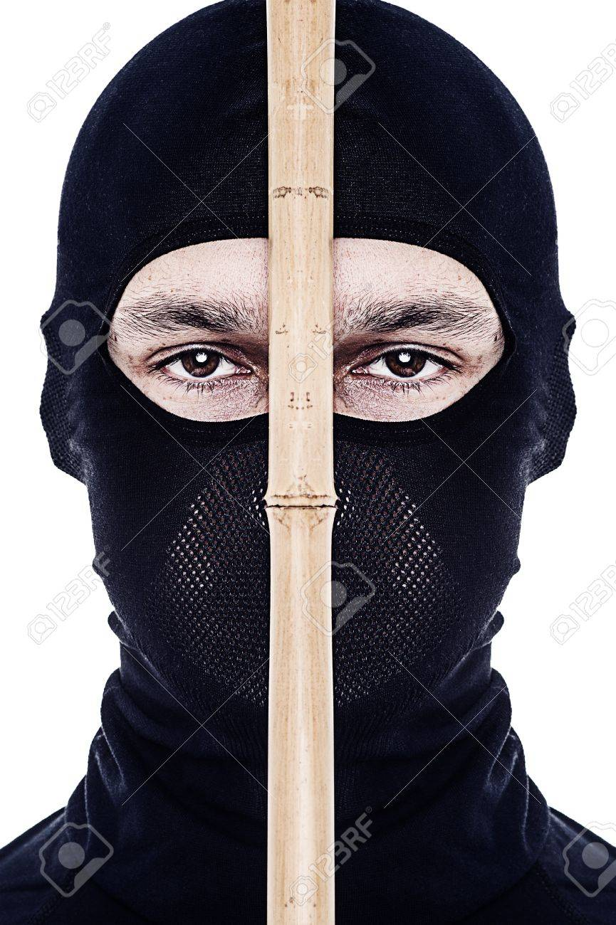 Close up portrait of male ninja in black mask covered his face on white background Stock Photo - 17418403