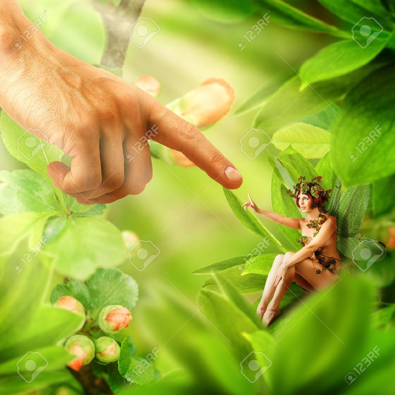 Human Hand Touching His Finger To Finger Of Garden Fairy Sitting