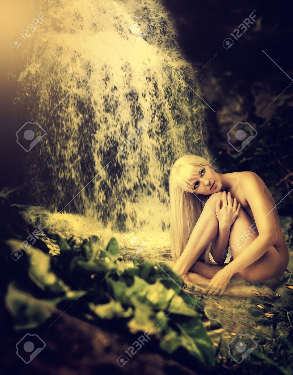 Beautiful fantasy summer landscape with lagoon, waterfall and sexy blond woman sitting in water Stock Photo - 19940246