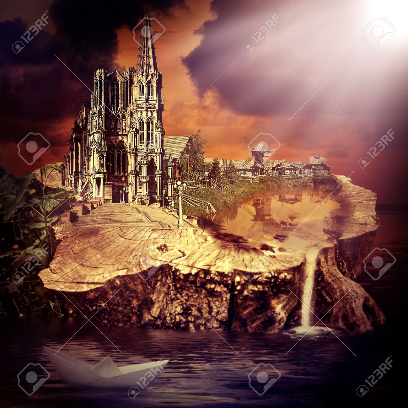 Fairy tale. fantasy castle and village on the stump in the water at sunset Stock Photo - 20234253