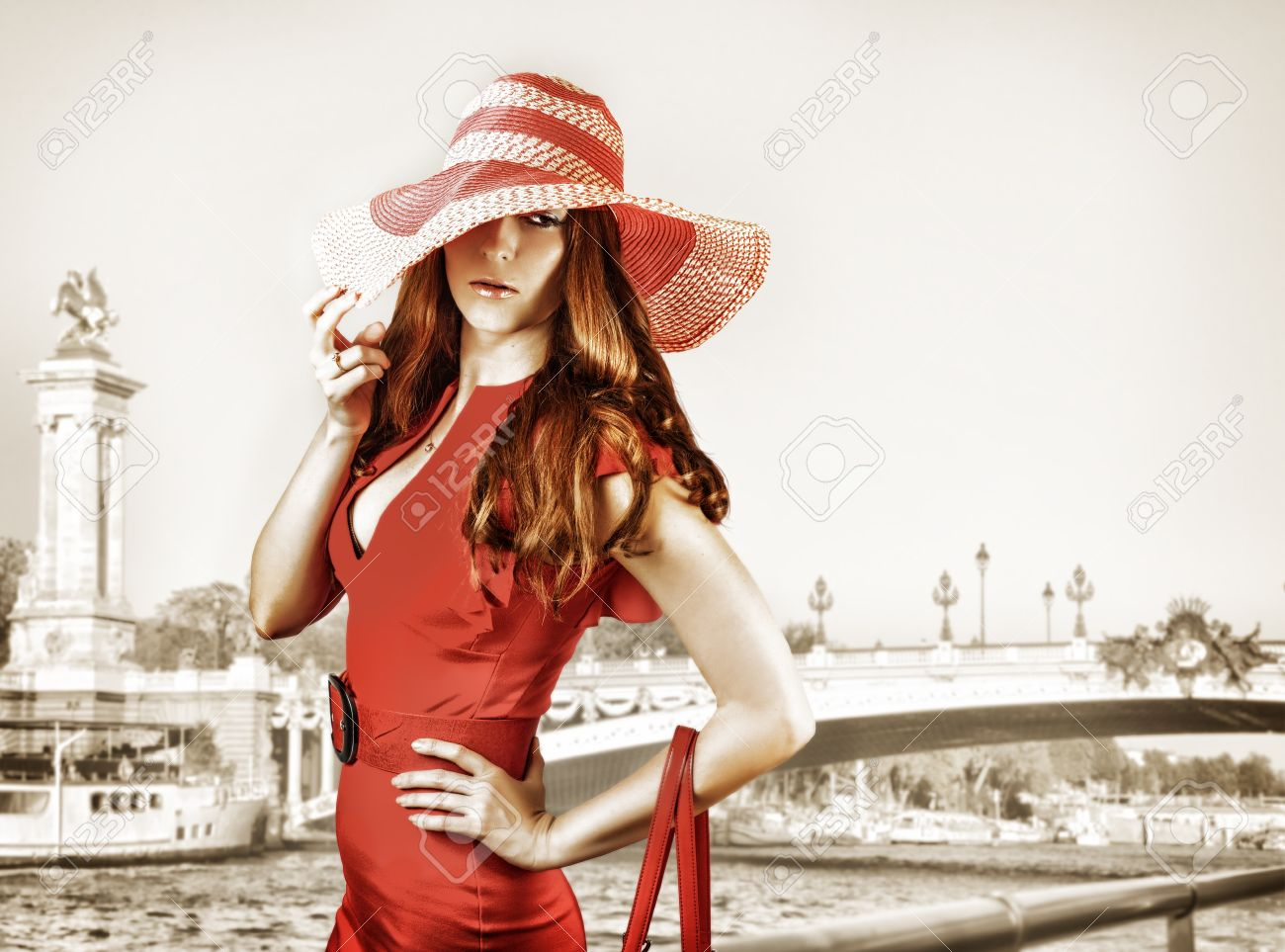 Young sexy fashionable woman wearing red hat and dress Stock Photo - 20961658