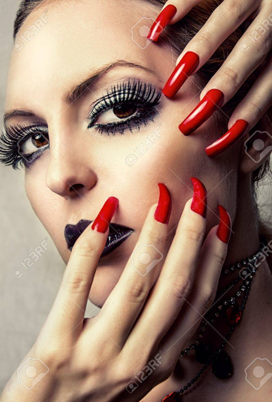 Beauty Woman With Perfect Gothic Makeup Beautiful Professional Holiday Make Up And Long False Red