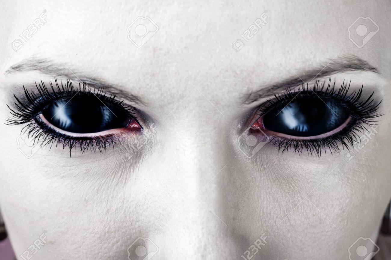 Evil black female alien, vampire or zombie eyes. dirt make up. Macro. Halloween theme Stock Photo - 21698571