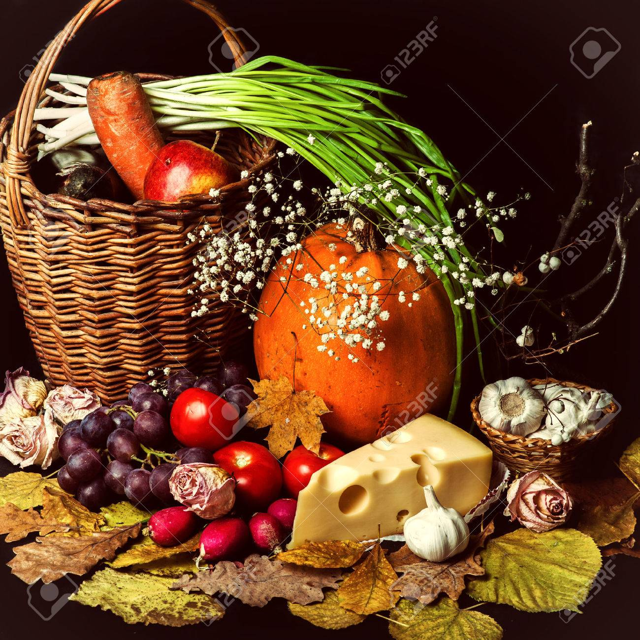 Beautiful autumn harvest of vegetables and leaves on black background Stock Photo - 22626807