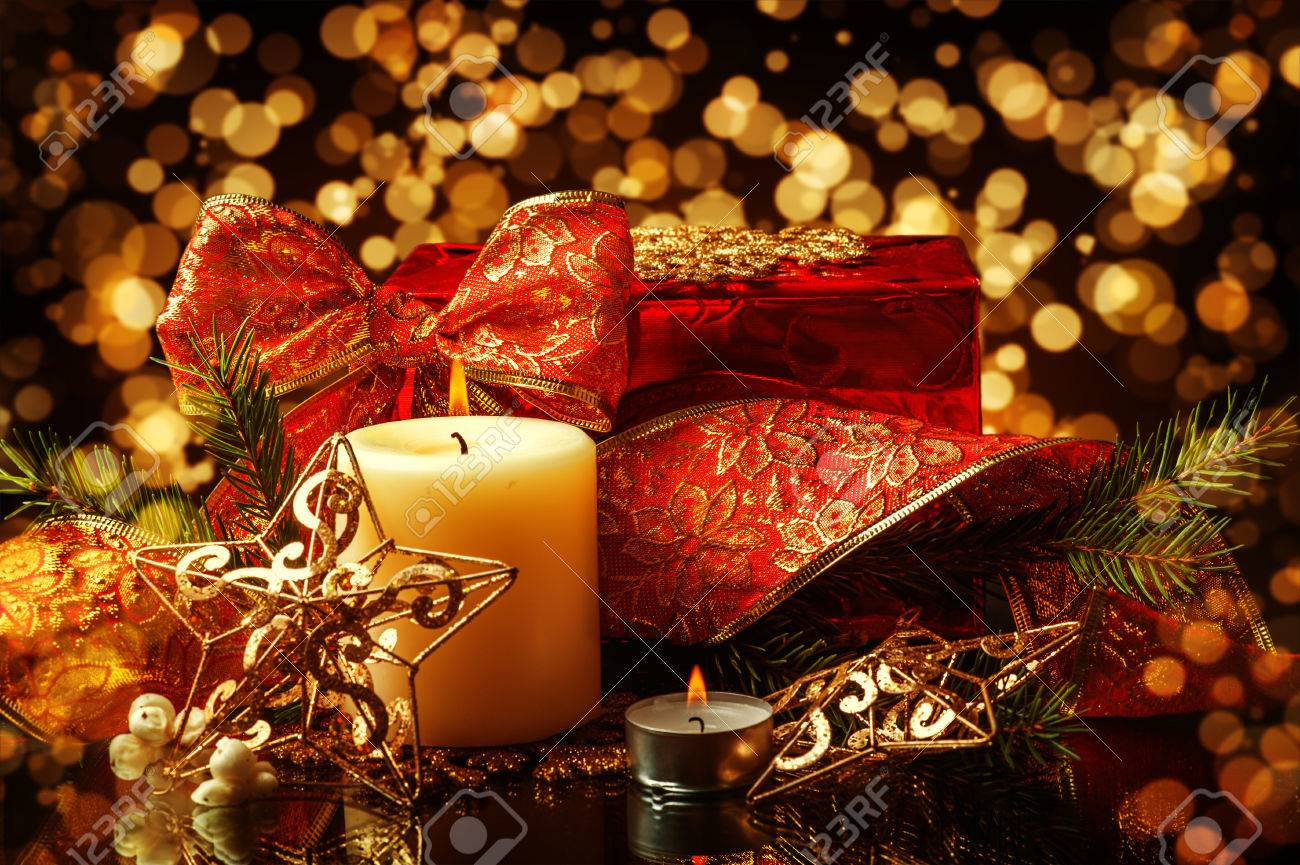 Christmas Decorations background for card - star, two candles and ribbon on fir tree branch Stock Photo - 23684648